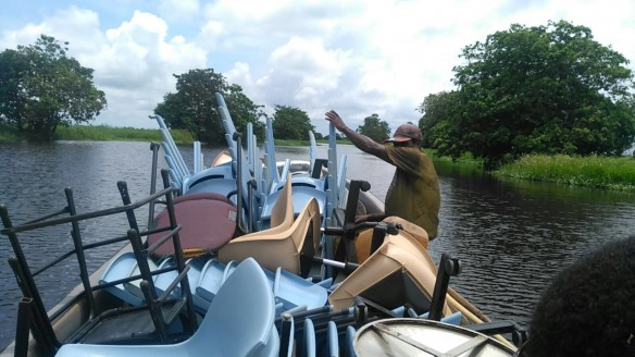 Boat taking desks to village
